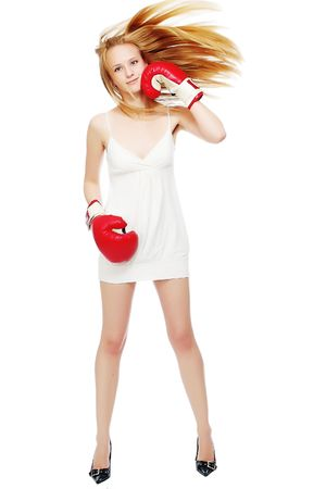 The woman is engaged in boxing in red gloves photo