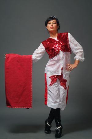 The woman of the Spanish appearance in a suit of a matador photo