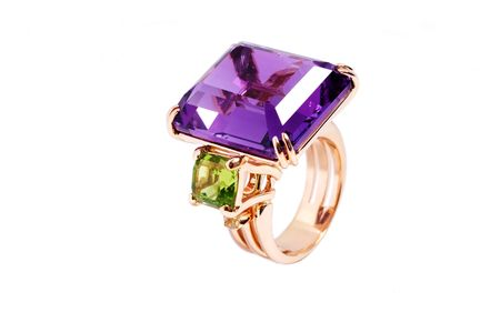 The big gold ring with an emerald and amethyst Stock Photo - 5066257