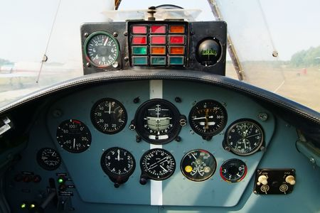 Kind on devices of the sports plane photo