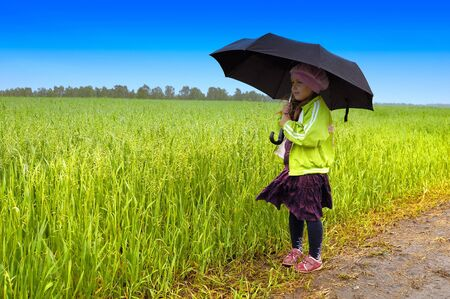 The lonely girl on a farmer field