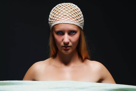 The young woman on a dark background photo