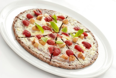 Appetizing fruit pizza on a white plate