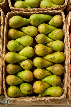 mass storage: Ripe green pears of a grade in a basket