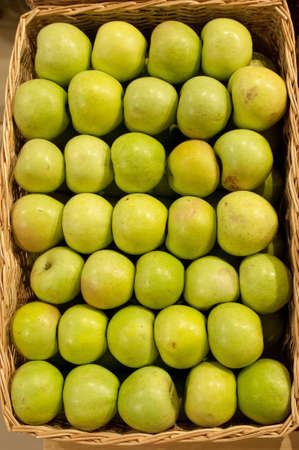Ripe green apples in a basket photo