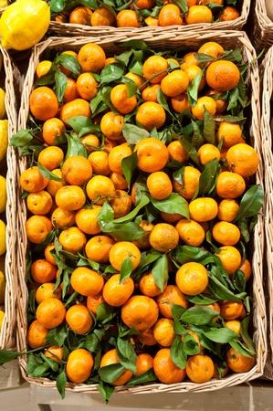 Ripe tangerines in a wattled basket photo