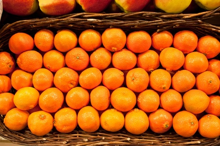 Ripe tangerines in a wattled basket Stock Photo - 12860477