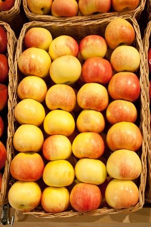 Ripe apples in a wattled basket photo