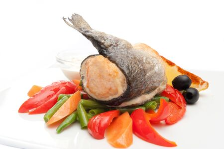 grayling: fried grayling with vegetables on white plate Stock Photo