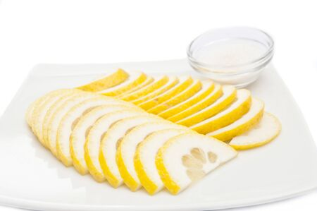 sliced lemon sauce on a white plate Stock Photo