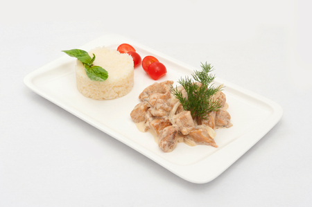 pikeperch: Asian dish with fish and rice on a white plate