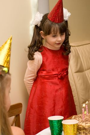 blow out: Girl is preparing to blow out lights at her birthday party
