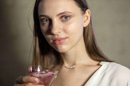 Portrait of beautiful fair young woman with jewelry, one light source Stock Photo