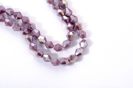 Beautiful Light purple Glass Sparkle Crystal Isoalted Beads on white background. Use for diy beaded jewelry