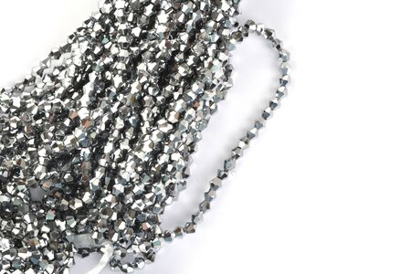 Beautiful color silver gray Glass Sparkle Crystal Isoalted Beads on white background. Use for diy beaded jewelry Stock Photo