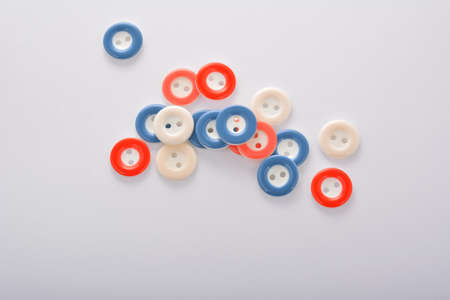Pile of colorful buttons on white background. use for tailoring and sew 스톡 콘텐츠