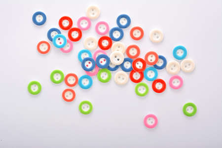 Pile of colorful buttons on white background. use for tailoring and sew Stok Fotoğraf