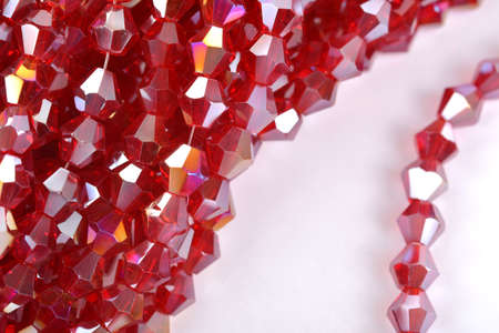 Beautiful Red scarlet, ruby Glass Sparkle Crystal Isoalted Beads on white background. Use for diy beaded jewelry. Space for text