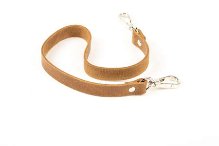 brown leather belt with carbine and metal accessories isolated on white background. use for bags and suitcases