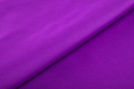 purple Knitted elastic fabric, weaving of threads texture, crumpled fold. For underwear, sports clothes and swimwear. Space for text. Standard-Bild - 157133506