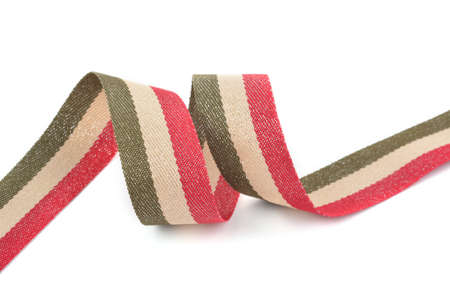 Red khaki green beige Cotton ribbon, strapping tape with curl on white backgroud. Use for sewing clothes, bags. Space for text.