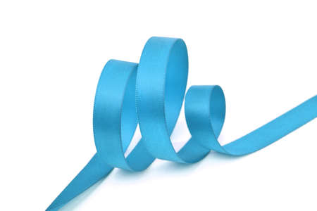 Curl of blue beautiful Satin silk holiday ribbon on a white background. copy Space for text.