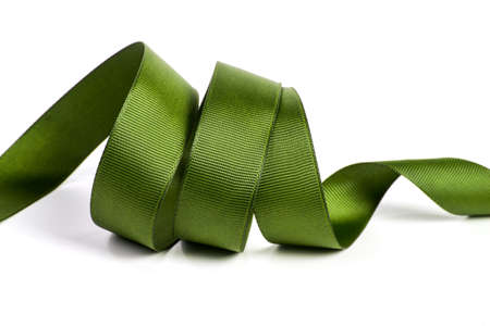 Curl of green beautiful Satin silk holiday ribbon on a white background. copy Space for text.