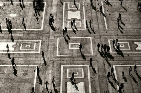 large group of people: Unrecognizable: People visible only as Silhouettes and shadows in Urban Environment