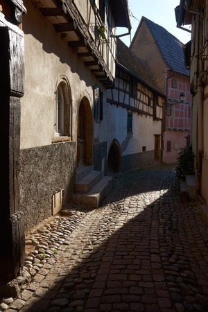 vins: Beautiful city Eguisheim in Alsace in France Stock Photo