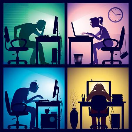 concentration: Man and woman sitting in front of screens in a dark office room.
