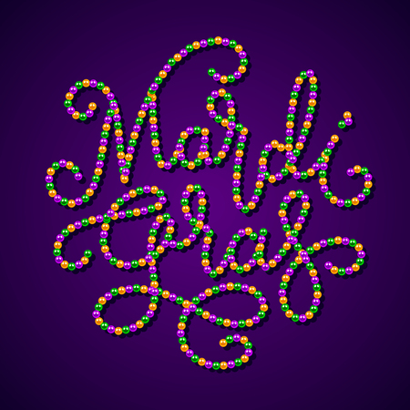 Mardi Gras lettering consist of gold, green, purple beads