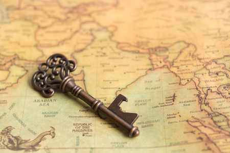 Key placed on the world map. Use as a concept solving the problem of each area. Stock Photo