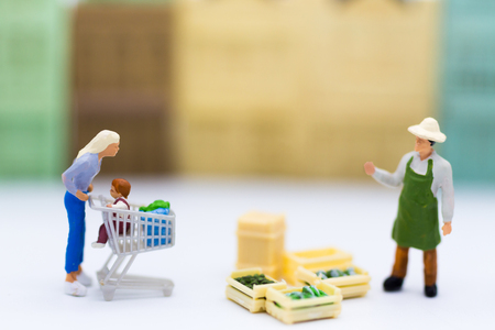 Miniature people : Shopping in the market for buy something necessary. Image use for marketing , business concept. Stock Photo