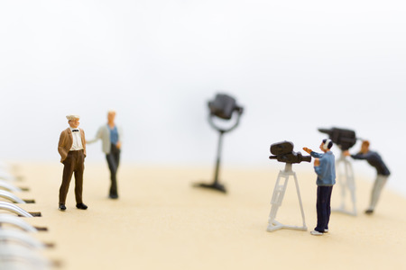 Miniature people : Small team of tv reporter with Celebrity Interviews, production television concept.