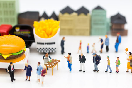 Miniature people: Group people talking about marketing, Trading business. Image use for Franchise business concept.