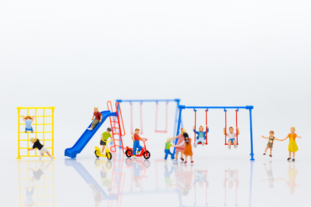 Miniature children: Group childrens are playing together on playground. Image use for Children's Day