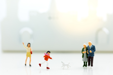Miniature family: Boy is running with dog. Image use for Family day. Stockfoto