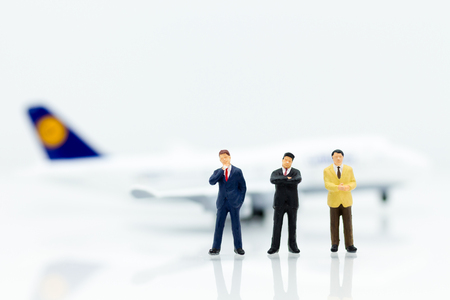 Miniature business people : businesses team with plane. Image use for background travel, business trip travel advisory agency of transportation concept.