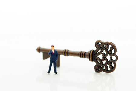 Miniature people: Businessmen stand with keys. Image use for key man, the key to success, business concept.