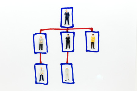 Miniature people : Businessman stand on business board. Image use for Executive board each position. Foto de archivo