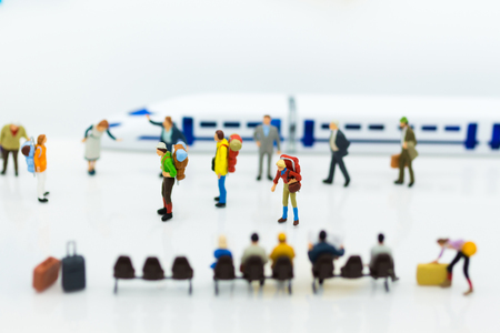 Miniature people: Many Travellers traveing by train at train station. Image use for Travel business concept. Stock Photo