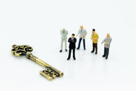 Miniature people: Group Businessmen stand with master key. Image use for key man, the key to success, business concept.