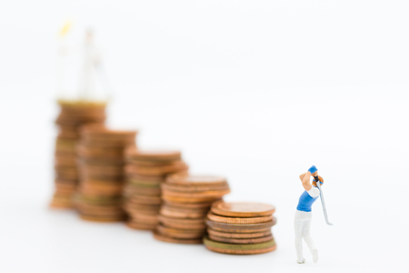 Miniature people : Businessmen spend their free time for Golf activities. Image use for sport, hobbies concept. Banco de Imagens