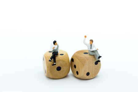 Miniature people : Businessman consult business ideas, dice with risk. Image use for to solve problems, business concept.