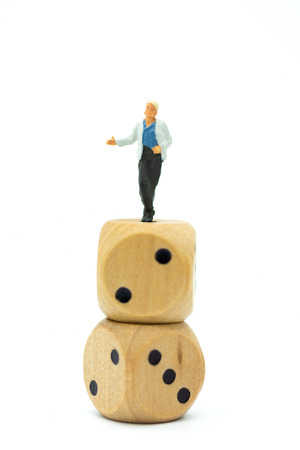 Miniature people : Women standing on dice. Image use for to solve problems, risk management , business concept. Stock Photo