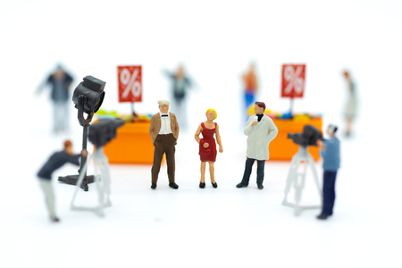 Miniature people: Moderator are interviewing businessman with camera and video capture. Image use for Entertainment Industry, retail business conecpt. Stock Photo