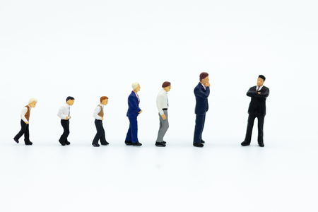 Miniature people: Businessman looking for employees for job placement. Image use for choice of the best suited employee, job recruiter concepts. Stock fotó