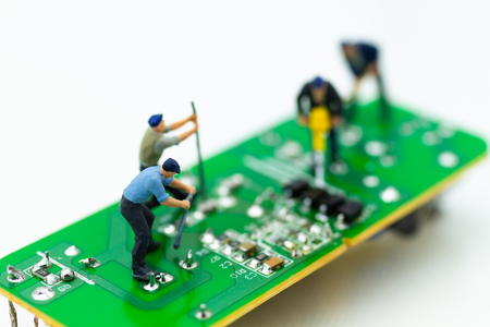 Miniature worker repairing mainboard, clear virus computer and repair, security and technology concept.