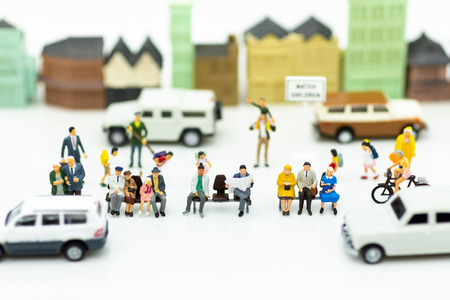Miniature people: Traffic within the capital, roaming between people and cars. Image use for business concept.