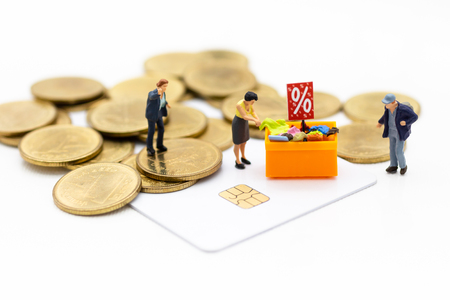 Miniature people:Shoppers with cash and credit or cashless. Image use for retail business, marketing concept.
